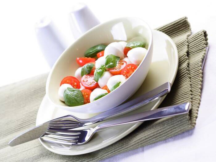 A light dinner placed in a bowl mostly comprising of salads.