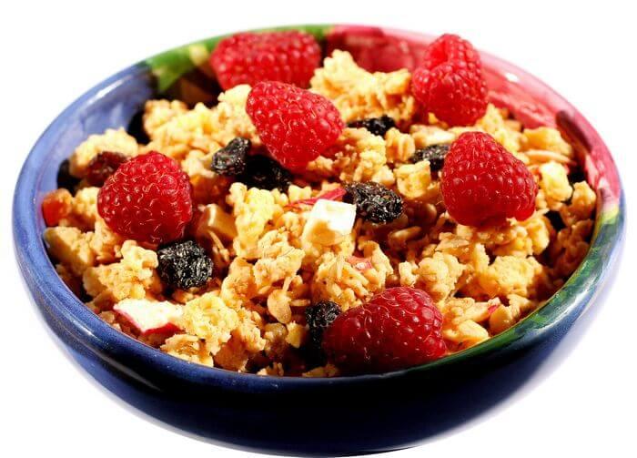 Breakfast bowl full of cereals, berries, etc.