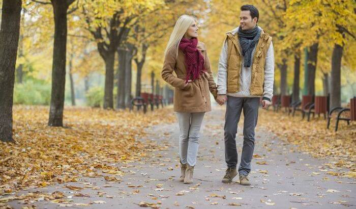 A couple walking in a park.