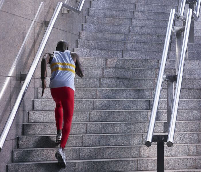 Athletic, young man running up the stairs.