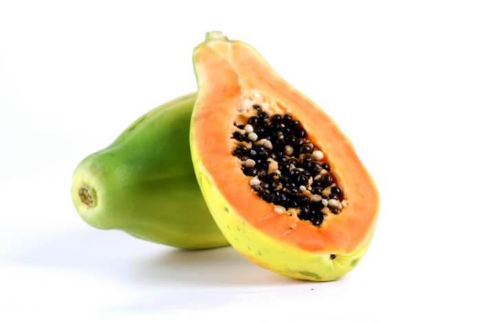 close up of half cut papaya with seeds inside