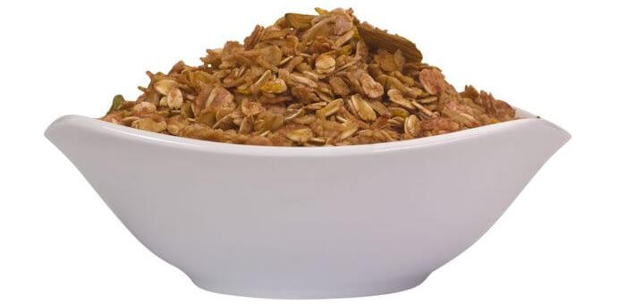 A bowl filled to the top with oats.