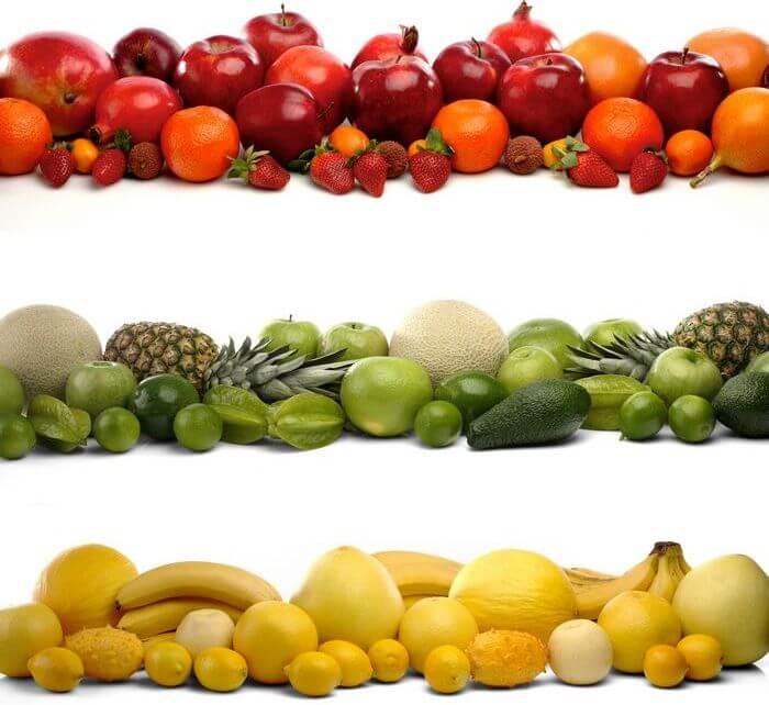 Lots of fruits and vegetables (like apples, oranges, bananas, pomegranate, pineapple, lemons, etc.) placed in rows on a white background.