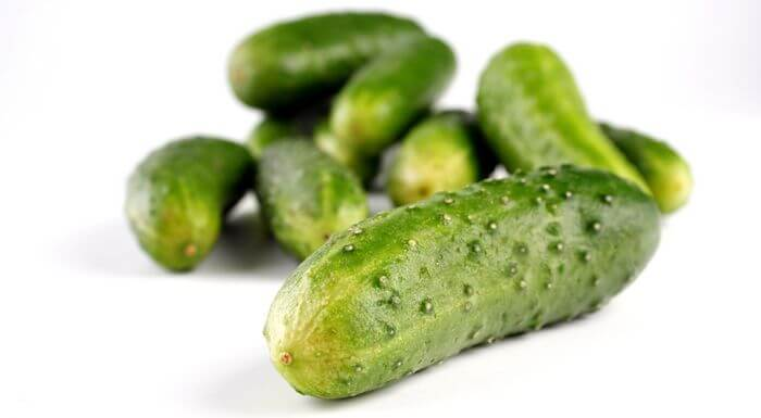 Close up of cucumbers placed on white background.