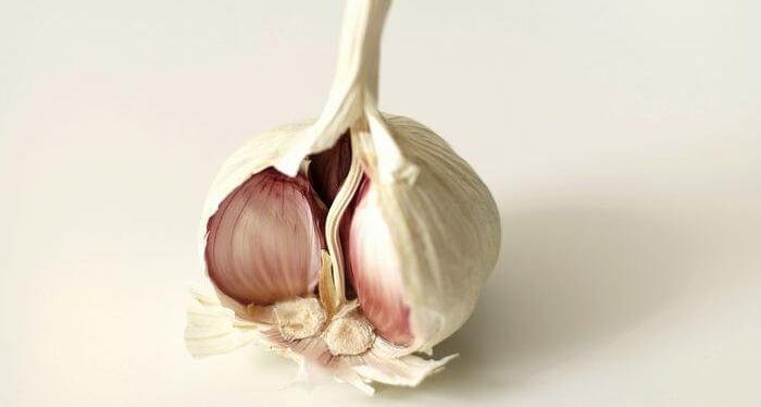Close up of raw garlic lobe.