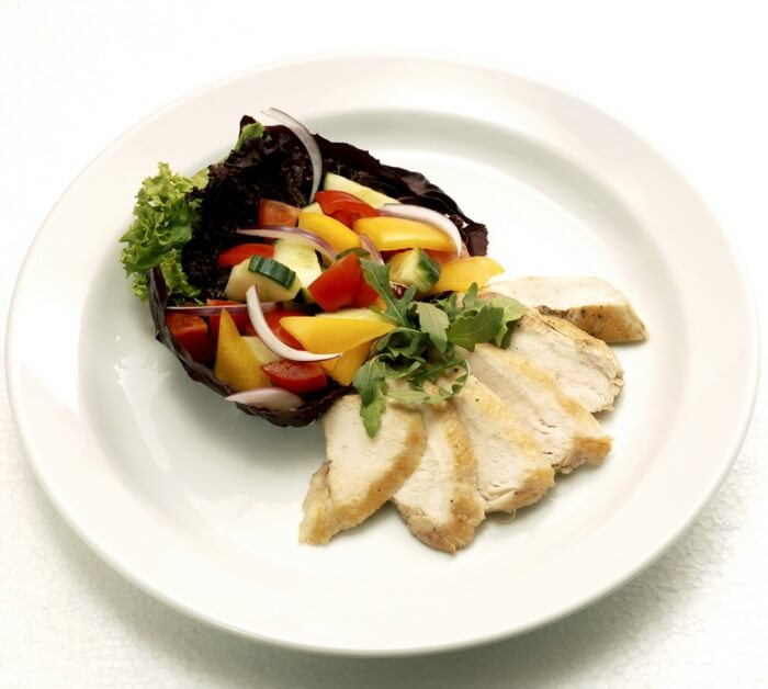Nutritious Food served in a plate: Colorful vegetables and chicken, rich in lean proteins, minerals, vitamins and carbohydrates; Required for building speed and stamina.