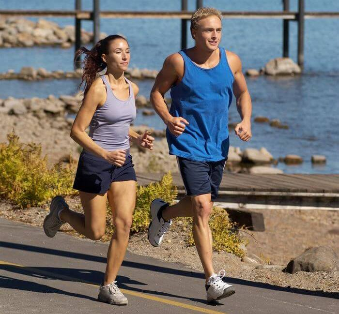 Man and women running together.
