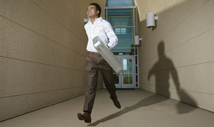 Business man in going and almost running to keep up with his schedule.