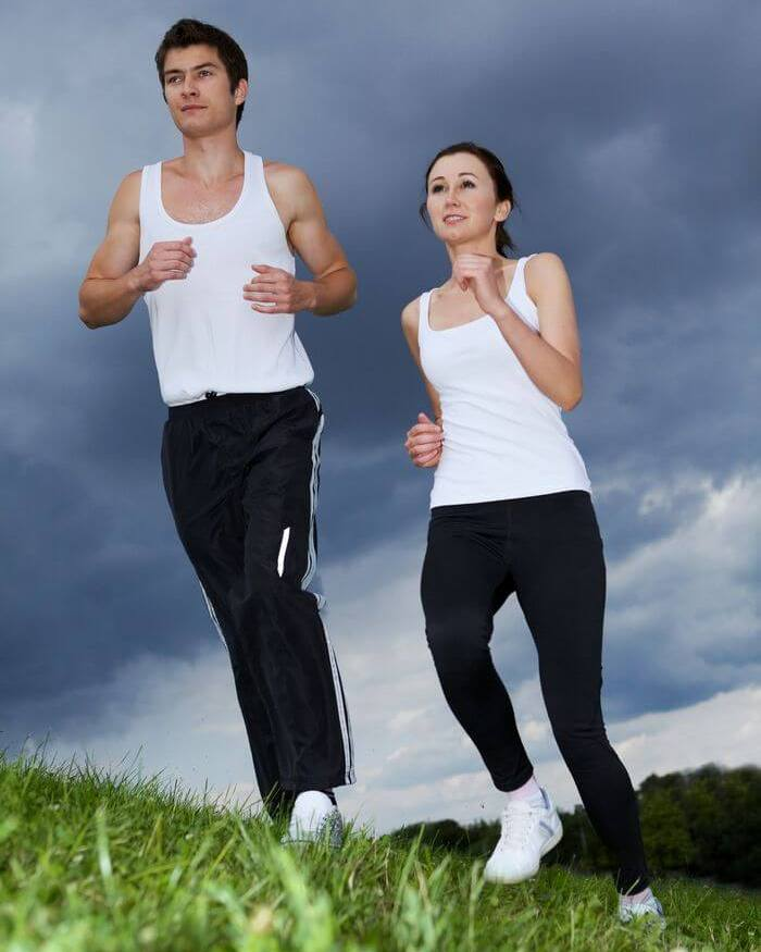 A couple running in a relaxed position.