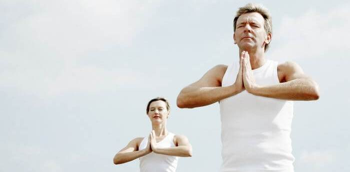 Man and woman doing yoga during day time.