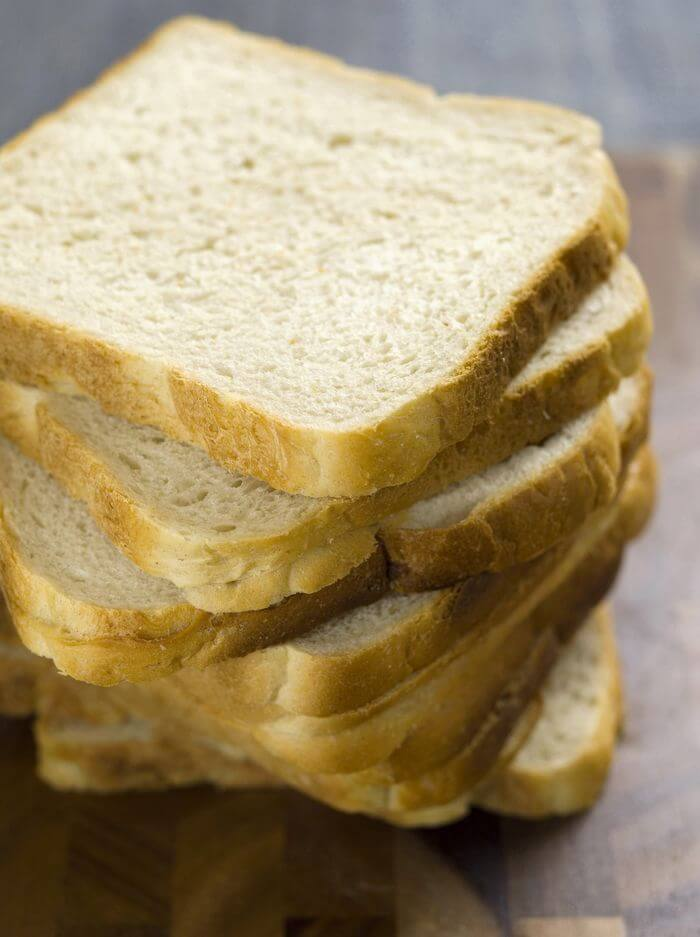 Stack of white bread that is full of carbohydrates.