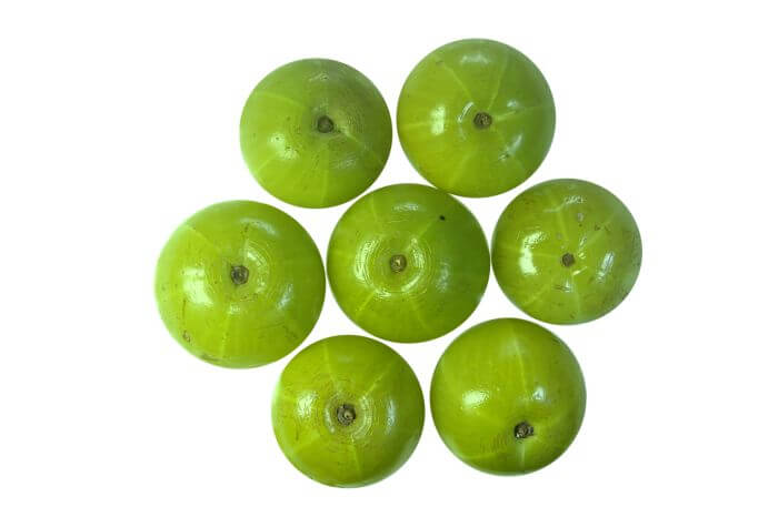 Whole Round 7 pieces of Amla (Indian gooseberry) placed on White Background.