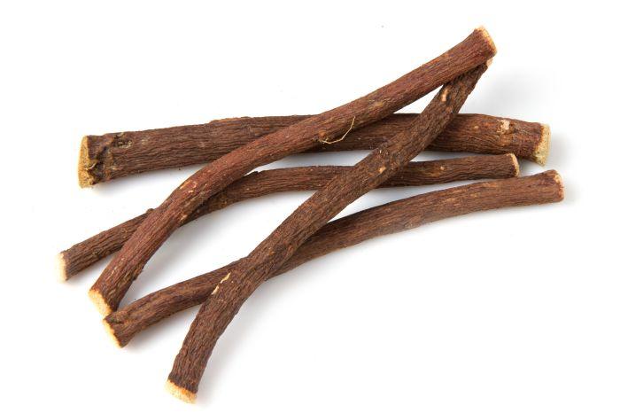 Licorice roots (sticks) isolated on white background