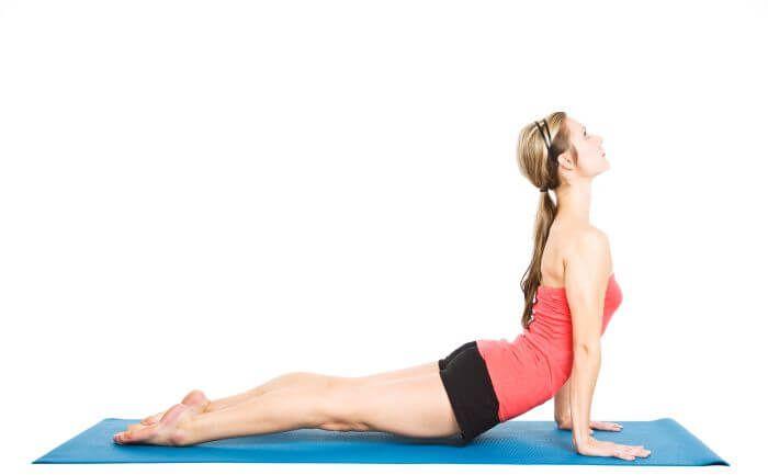Woman in Yoga Cobra Pose (Bhujangasana)