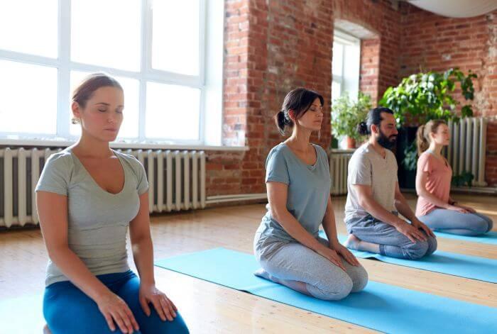 Group of people in Vajrasana - Yoga